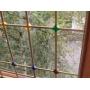 Окна со встроенными решетками и защитными стеклопакетами