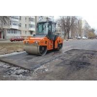асфальтировка дороги в Омске