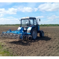 Вспашка, дискование земли трактором