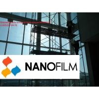 Установка энергосберегающей пленки NANOFILM на стекла зданий